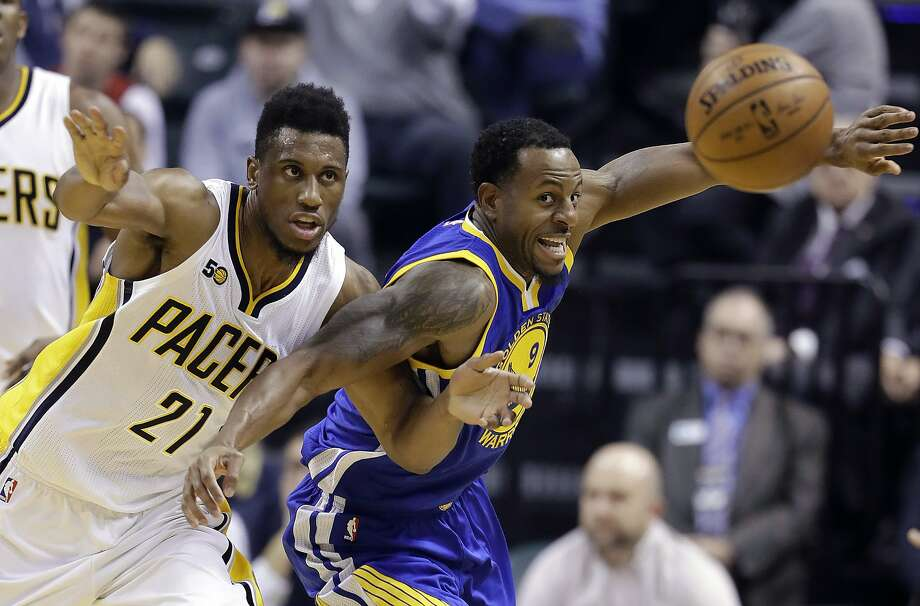 Indiana Pacers' Thaddeus Young (21) and Golden State Warriors' Andre Iguodala go for the ball during the first half of an NBA basketball game Monday, Nov. 21, 2016, in Indianapolis. (AP Photo/Darron Cummings) Photo: Darron Cummings, Associated Press