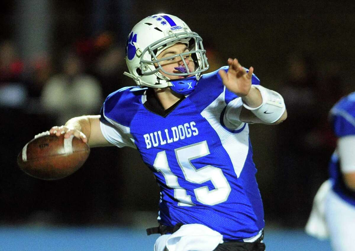 Bunnell QB Michael Castelot prepares to throw a pass during Thanksgiving Eve football action against Stratford in Stratford, Conn. on Wednesday Nov. 23, 2016.