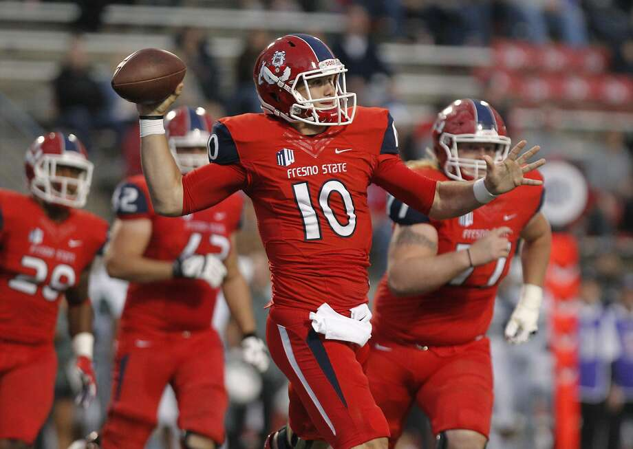 Fresno State's Zach Kline on a roll out pass against Hawaii during the first half of an NCAA college football game in Fresno, Calif., Saturday, Nov. 19, 2016. (AP Photo/Gary Kazanjian) Photo: GARY KAZANJIAN, Associated Press