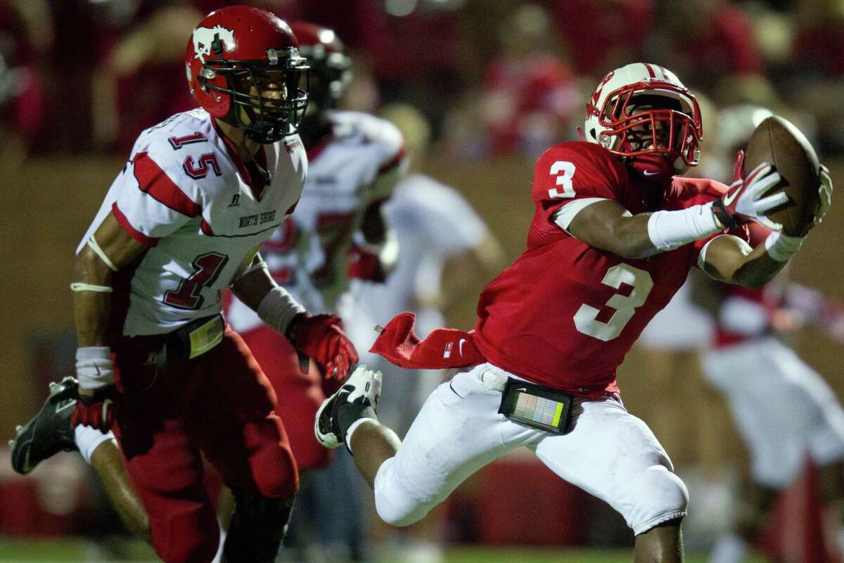 Katy receiver Jordan Thompson hauls in a long touchdown pass as North Shore defensive back Kevin Alexander defends during the third quarter of a high school football game at Rhodes Stadium Friday, Aug. 26, 2011, in Katy. ( Smiley N. Pool / Houston Chronicle )