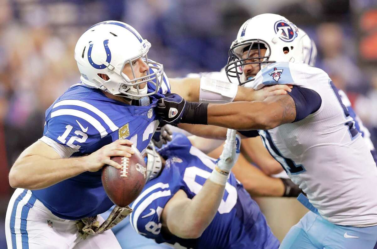 The battering Andrew Luck, left, regularly takes behind a porous offensive line has caught up with him.