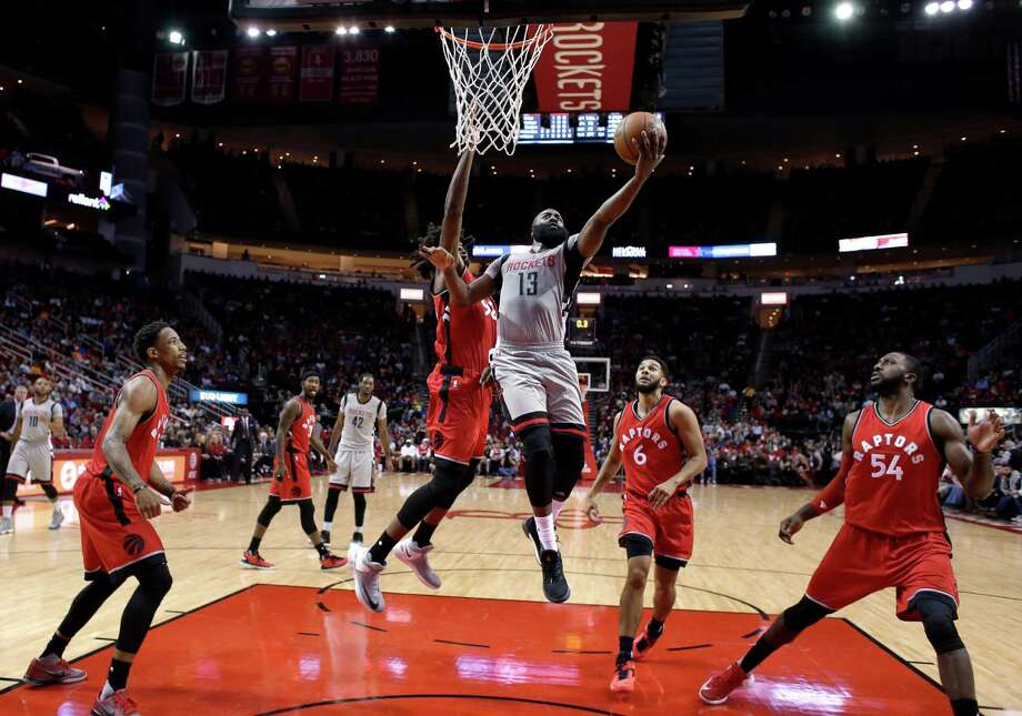 Houston Rockets' James Harden (13) goes up for a shot as Toronto Raptors' Lucas Nogueira, center left, defends during the first quarter of an NBA basketball game Wednesday, Nov. 23, 2016, in Houston. (AP Photo/David J. Phillip) Photo: David J. Phillip, Associated Press / Copyright 2016 The Associated Press. All rights reserved.