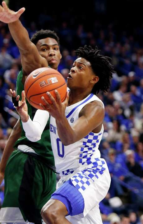 Kentucky's De'Aaron Fox, a freshman from Cypress Lakes, drives on Cleveland State's Evan Clayborne. Photo: James Crisp, FRE / FR6426 AP