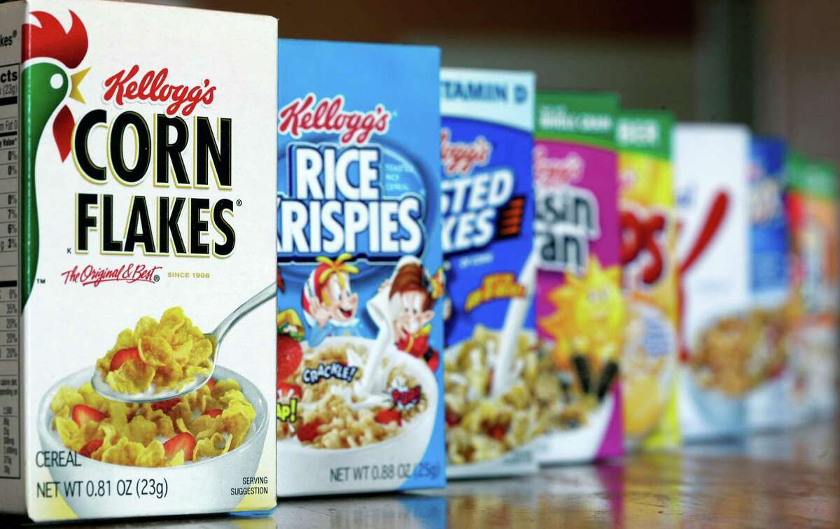 """FILE - This Feb. 1, 2012, file photo, shows Kellogg's cereal products, in Orlando, Fla. On its website, amid news of Pop-Tarts and Frosted Flakes, Kellogg touted a distinguished-sounding Â?""""breakfast councilÂ?"""" of Â?""""independent expertsÂ?"""" dedicated to guiding its nutritional efforts. Nowhere did it say that Kellogg paid the council members and spoon-fed them talking points about the benefits of cereal and breakfast, according to a copy of a contract and email exchanges obtained by The Associated Press. (AP Photo/John Raoux, File)"""