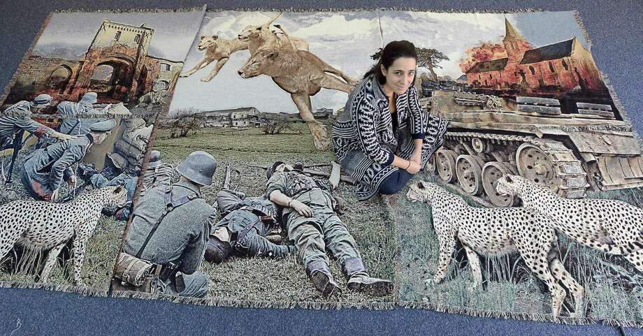 "Rose DeSiano, an artist/photographer whose exhibit ""War Tapestries"" will be on display at the UConn Stamford Art Gallery. Rose is photographed on Nov. 11, 2016 as she installs a series of  photograph re-enactments of famous war scenes for her series of images that she displays through tapestries as a canvas. Photo: Matthew Brown / Hearst Connecticut Media / Stamford Advocate"
