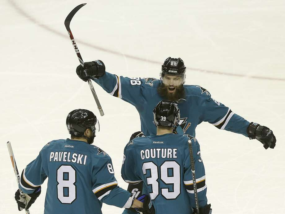 San Jose Sharks center Logan Couture (39) celebrates after scoring a goal with center Joe Pavelski (8) and defenseman Brent Burns (88) during the first period of an NHL hockey game against the Chicago Blackhawks in San Jose, Calif., Wednesday, Nov. 23, 2016. (AP Photo/Jeff Chiu) Photo: Jeff Chiu, Associated Press