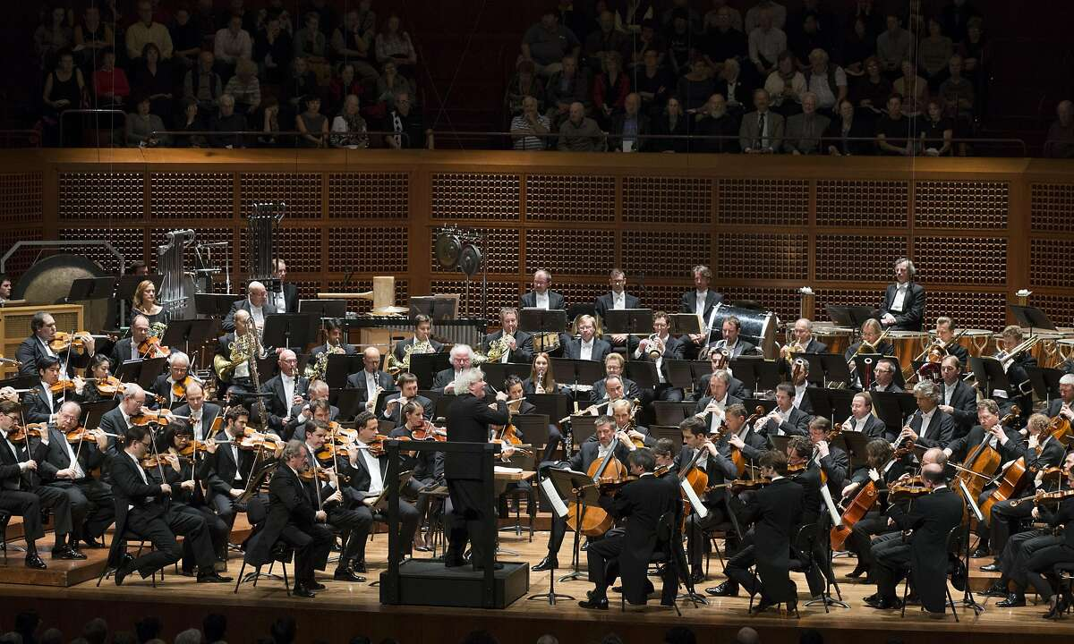 """Artistic Director Simon Rattle, center, leads the Berlin Philharmonic in a performance of Schoenberg's """"Five Pieces for Orchestra, Opus 16,"""" at the San Francisco Symphony, Wednesday, Nov. 23, 2016 at Davies Symphony Hall in San Francisco, Calif."""