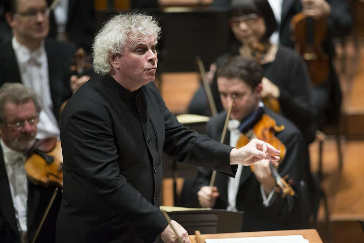 """Artistic Director Simon Rattle leads the Berlin Philharmonic in a performance of Schoenberg's """"Five Pieces for Orchestra, Opus 16,"""" at the San Francisco Symphony, Wednesday, Nov. 23, 2016 at Davies Symphony Hall in San Francisco, Calif."""