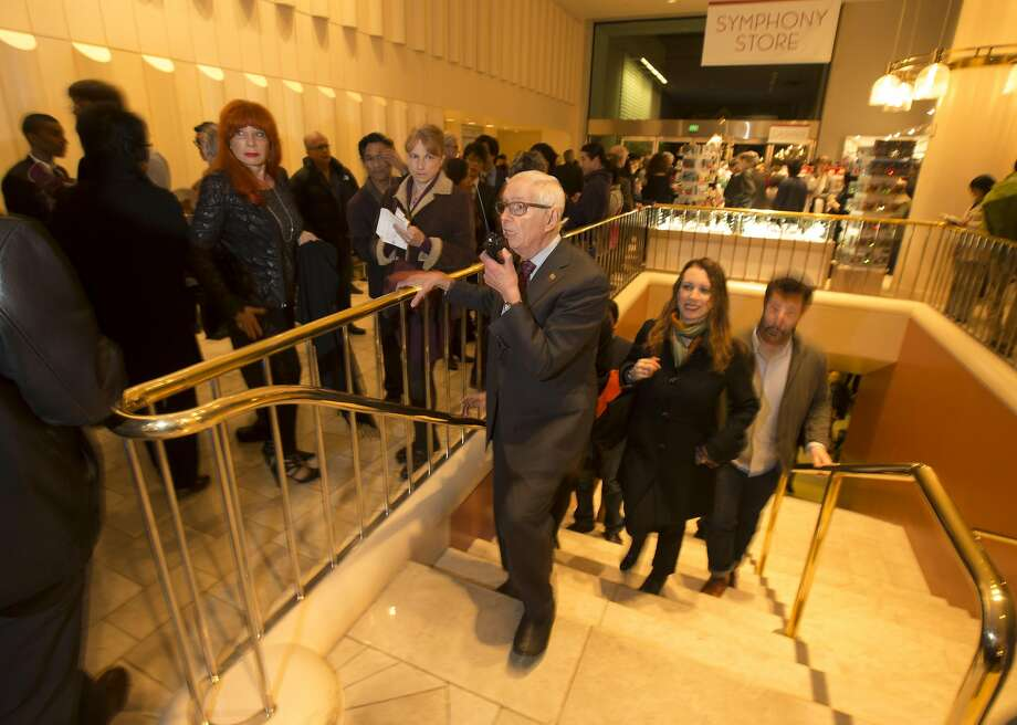 Horacio Rodriguez (center), working his final night at Davies Symphony Hall, responds to a colleague on his walkie-talkie. Photo: D. Ross Cameron, Special To The Chronicle