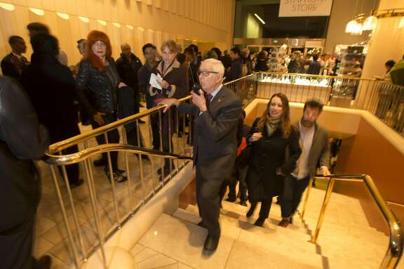 Horacio Rodriguez, center, who has been the head usher at Davies Symphony Hall, responds to a colleague over his walkie-talkie as he works his final night at the venue before retiring after 36 years, Wednesday, Nov. 23, 2016 in San Francisco, Calif. Rodriguez, 85, has worked for the San Francisco Symphony since Davies opened in 1980.