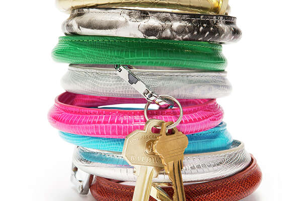 """O-VENTURE KEY RING, $28-$55   The O-Venture key ring is the answer for any woman who's thought, """"Why wasn't I born with another set of hands?""""   The O-Venture motto, """"Carry only what you need,"""" is a reminder to focus on life's essentials.   The large ring is easily carried on the arm, making it a simple, but highly functional accessory.   O-Venture also sells card cases and money clips for those who can't fathom such a minimalistic life.    Buy it:  Bando's Gifts and Boutique, 215 N. 11 St., Beaumont; Flagship Mailroom, 148 S. Dowlen Road, Beaumont; For Heaven's Sake, 4190 Calder Ave., Beaumont; or online at o-venture.com"""