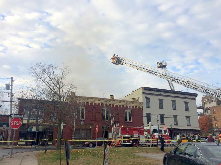 Firefighters fight a fire that damaged multiple buildings on Putnam Street in Saratoga Springs early Thanksgiving morning, Nov. 24, 2016. (Leigh Hornbeck/Times Union) Photo: Picasa