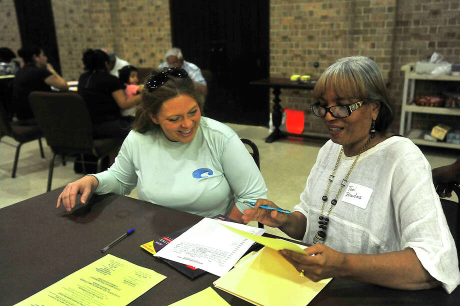 Toni Prados (right) trains new volunteer Sarah Stewart on how to manage the initial intake process as volunteers get to work signing up families in need of assistance with Christmas gifts on the first day of enrollment for the annual Beaumont Enterprise Empty Stocking Fund program at First United Methodist Church in Beaumont.  Photo taken Monday, November 7, 2016 Kim Brent/The Enterprise Photo: Kim Brent / Beaumont Enterprise