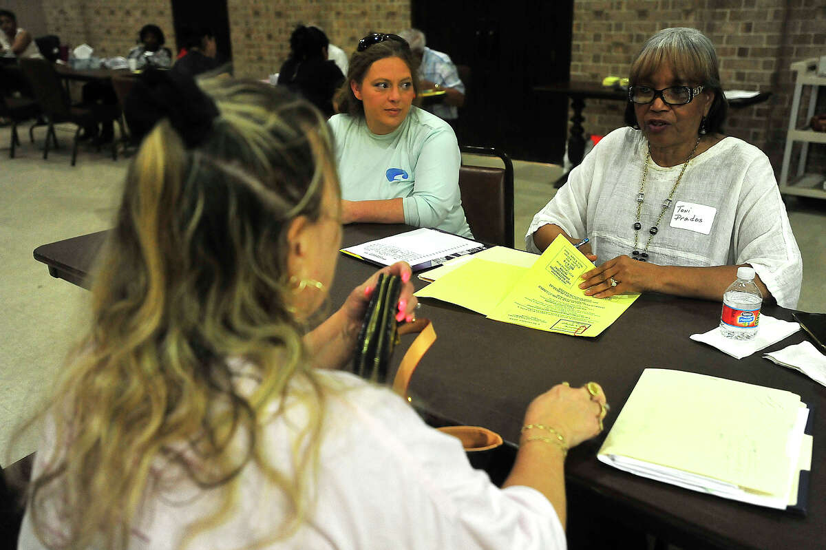 Toni Praods (right) talks with a client while helping train new volunteer Sarah Stewart on intake procedures as volunteers get to work signing up families in need of assistance with Christmas gifts on the first day of enrollment for the annual Beaumont Enterprise Empty Stocking Fund program at First United Methodist Church in Beaumont. Photo taken Monday, November 7, 2016 Kim Brent/The Enterprise