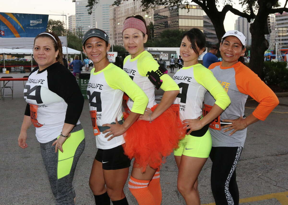 People pose for a photo at the 2016 Houston Turkey Trot, Thursday, Nov. 24, 2016, in Houston.