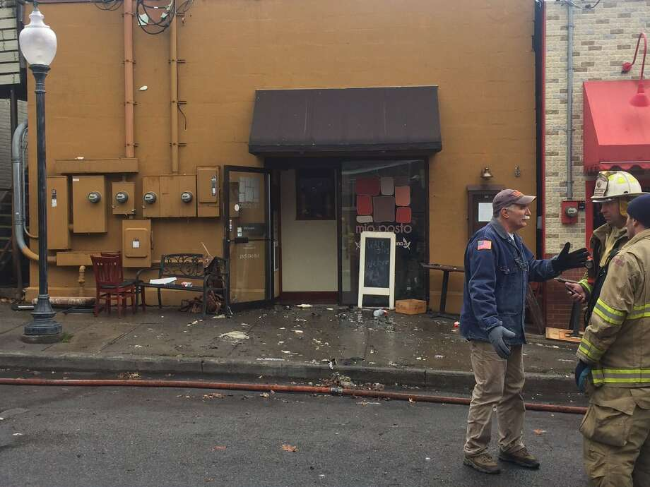 A fire early on Nov. 24, 2016 started at Mio Posto on Putnam Street, then spread to conjoined buildings in Saratoga Springs. (Robert Downen/Times Union)