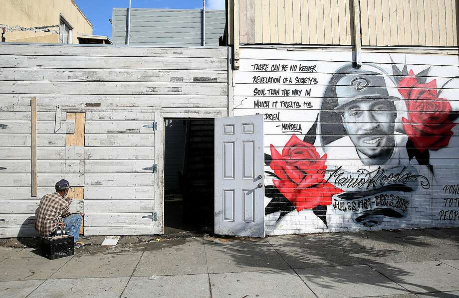 The mural for Mario Woods seen on Oakdale at Third streets on Tuesday, November 22, 2016, in San Francisco, Calif.   Mario Woods, 26 years old, was shot December 2 last year by police near Fitzgerald Ave. on Third St. Photo: Liz Hafalia, The Chronicle
