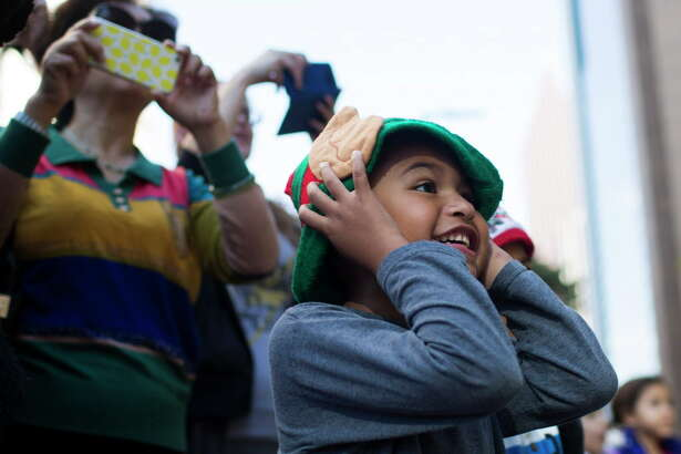 Angel Garcia, 5, covers his ears under the elf ears after the one of the parade floats honks the horn during the 67th Annual HEB Thanksgiving Parade, Thursday, Nov. 24, 2016, in Houston.