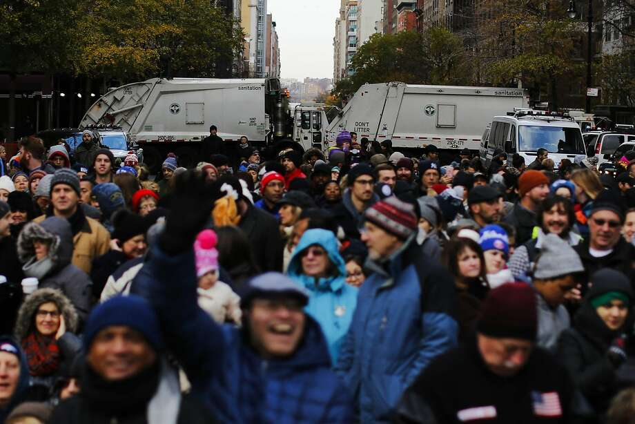 NEW YORK, NY - NOVEMBER 24: People arrive to watch the 90th Macy's Annual Thanksgiving Day Parade as trucks block the entrance to protect spectators on November 24, 2016 in New York City.  Security was tight in New York City on Thursday for Macy's Thanksgiving Day Parade after ISIS called supporters in the West to use rented trucks in attacks as similar as the ones operated in France this summer where at least 86 people were killed.(Photo by Eduardo Munoz Alvarez/Getty Images) Photo: Eduardo Munoz Alvarez, Getty Images
