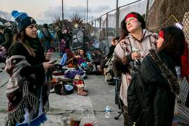 From right: Lorena Moreno gets her face painted by Michelle Ruiz-Esparza as Mayra Cervantes (left) watches, during the Indigenous People's Sunrise Gathering at Alcatraz Island, on Thursday, Nov. 24, 2016 in San Francisco, Calif. The gathering has been an annual tradition since 1975. Also known as Unthanksgiving Day, the event commemorates the 1969-71 occupation of Alcatraz by American Indians. The women are Mexika dancers.