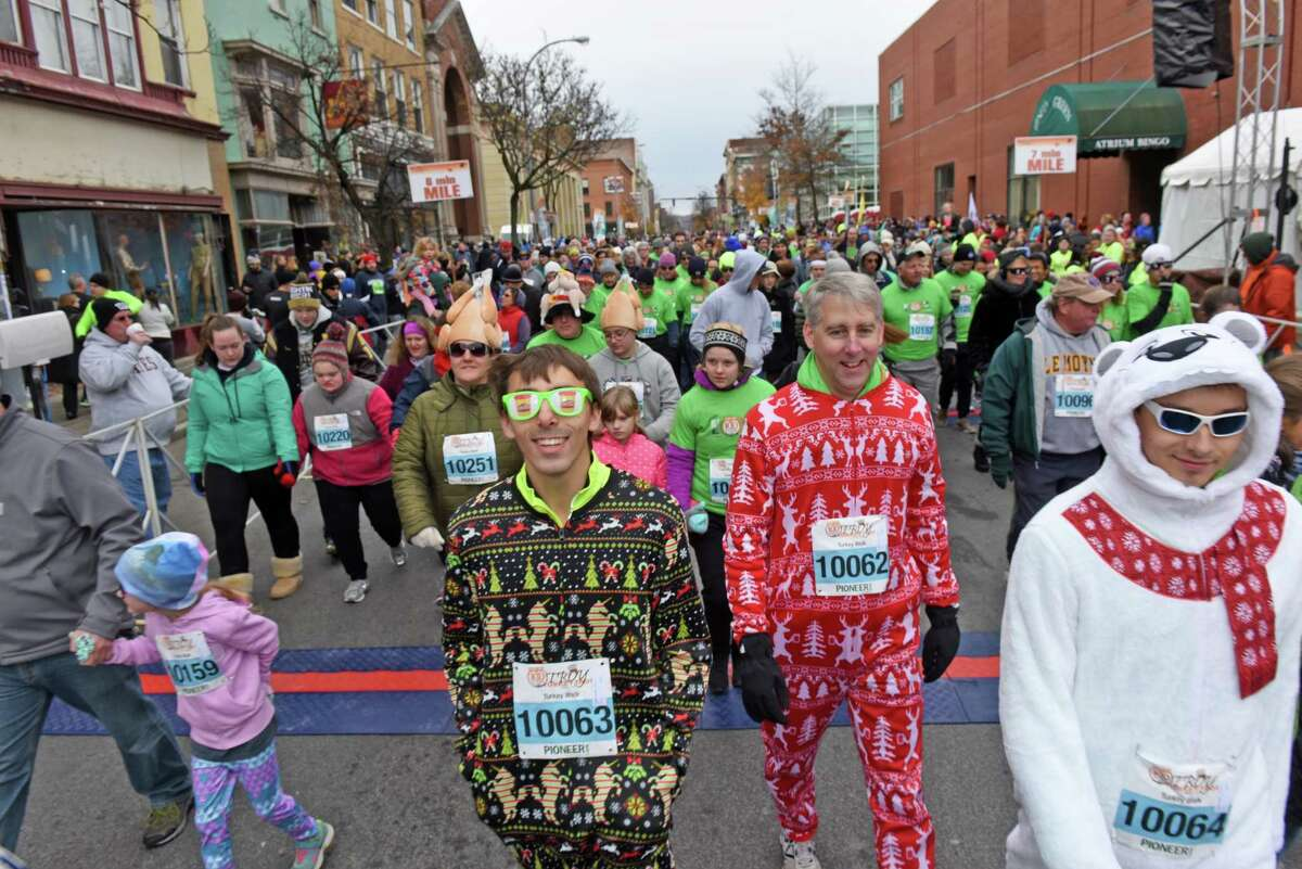 Walkers break from the start of the mile walk during the 2016 Troy Turkey Trot on Thursday Nov. 24, 2016 in Troy, N.Y. (Michael P. Farrell/Times Union)