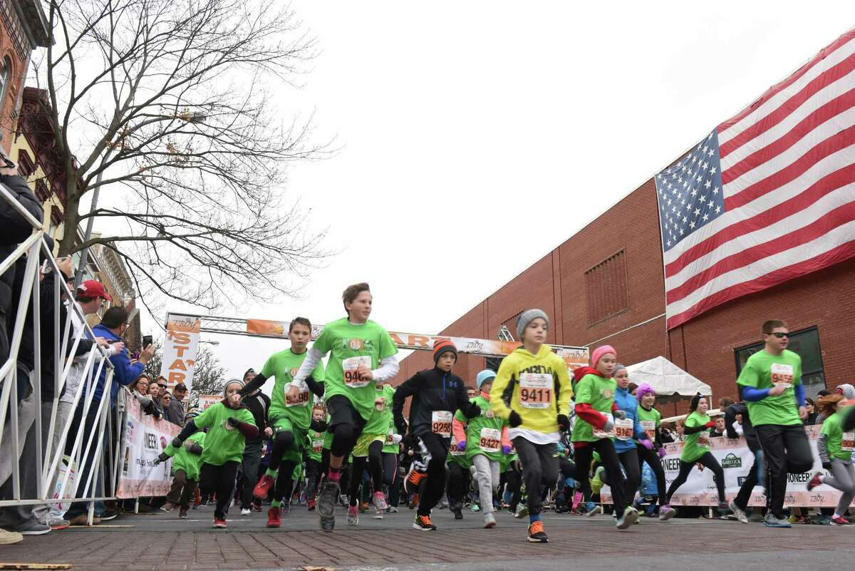 Grade school mile participants break from the start during the 2016 Troy Turkey Trot on Thursday Nov. 24, 2016 in Troy, N.Y. (Michael P. Farrell/Times Union)