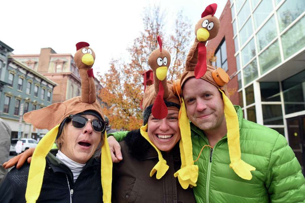 Nancy Gorski, left, Shelby Neal, center, and Orin Neal take part in the festivities during the 2016 Troy Turkey Trot on Thursday Nov. 24, 2016 in Troy, N.Y. (Michael P. Farrell/Times Union)