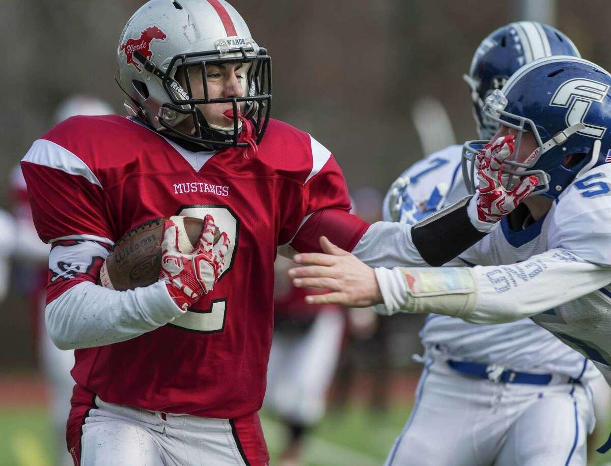 Fairfield Warde High School?'s Mike Whiting runs with the ball during their annual Thanksgiving Day football game against Fairfield Ludlowe High School played at Fairfield Warde High School, Fairfield, CT Thursday, November 24, 2016.