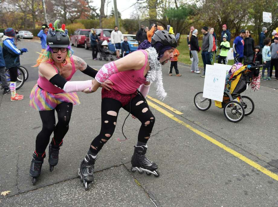 Jim McCaffrey, left, of Trumbull, and Jeff Piedmont, of Stamford, rollerblade in costume before the start of the Shippan Turkey Trot at Shippan Point in Stamford, Conn. Thursday, Nov. 24, 2016. The Thankgiving Day fun run, now in its 16th year, drew about 300 participants dressed in a variety of wacky and holiday-themed costumes. An estimated $10,000 raised by the run goes 100% to meal programs at Stamford's Pacific House. Photo: Tyler Sizemore, Hearst Connecticut Media / Greenwich Time