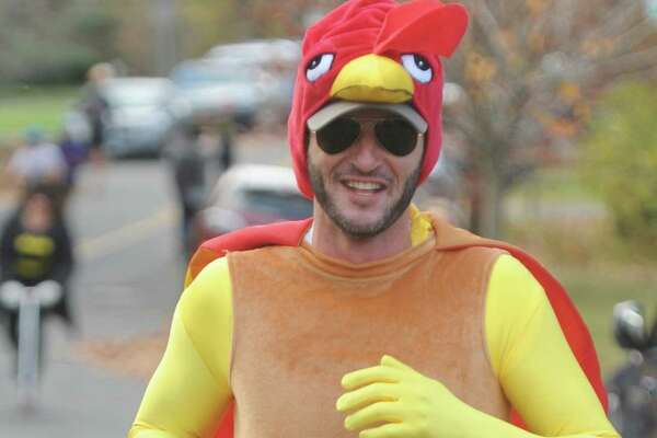 Dressed in a turkey costume, Boston resident Tom Juster runs in the Shippan Turkey Trot at Shippan Point in Stamford, Conn. Thursday, Nov. 24, 2016. The Thankgiving Day fun run, now in its 16th year, drew about 300 participants dressed in a variety of wacky and holiday-themed costumes. An estimated $10,000 raised by the run goes 100% to meal programs at Stamford's Pacific House.
