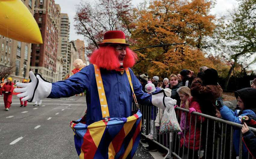 A clown greets spectators during the Macy's Thanksgiving Day parade, Thursday, Nov. 24, 2016, in New York. (AP Photo/Julie Jacobson)
