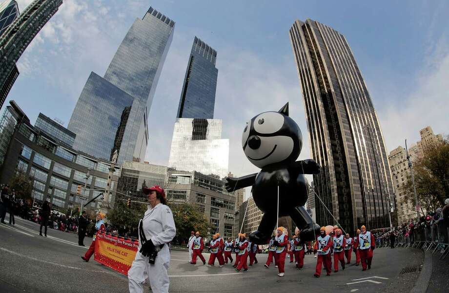 The Felix the Cat balloon is guided through Columbus Circle during the Macy's Thanksgiving Day parade, Thursday, Nov. 24, 2016, in New York. The balloon was one of the original balloons to appear in the first Macy's Parade. (AP Photo/Julie Jacobson) Photo: Julie Jacobson, Associated Press / Copyright 2016 The Associated Press. All rights reserved.