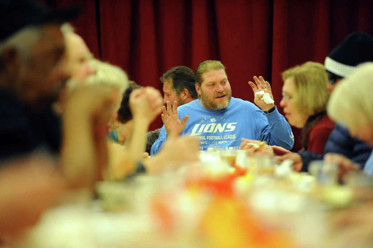 Scott Lord, of New Canaan, talks while taking a break from a huge Thanksgiving dinner hosted by the First Congregational Church inside their church in Stamford, Conn. on Thursday, Nov. 24, 2016.
