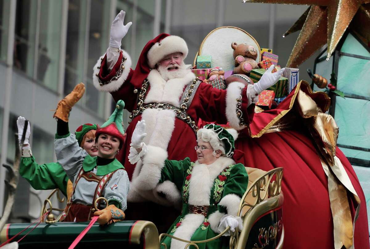 Santa Claus waves from his float as he passes along Sixth Avenue during the Macy's Thanksgiving Day parade, Thursday, Nov. 24, 2016, in New York. (AP Photo/Julie Jacobson)