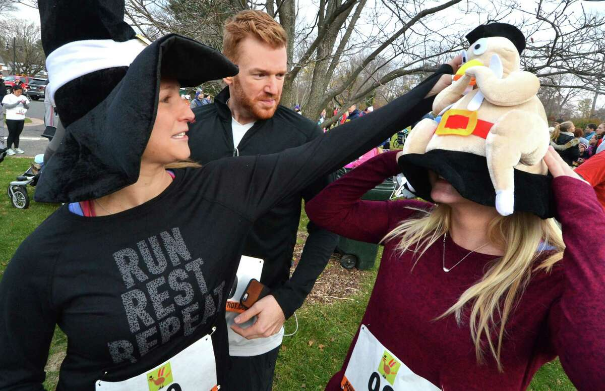 Rachel Ramsey and Chris Devine help Madonna Wadolowski get her turkey hat on before the annual Rowayton Turkey Trot held on Thanksgiving morning on Thursday November 24, 2016 in Norwalk Conn