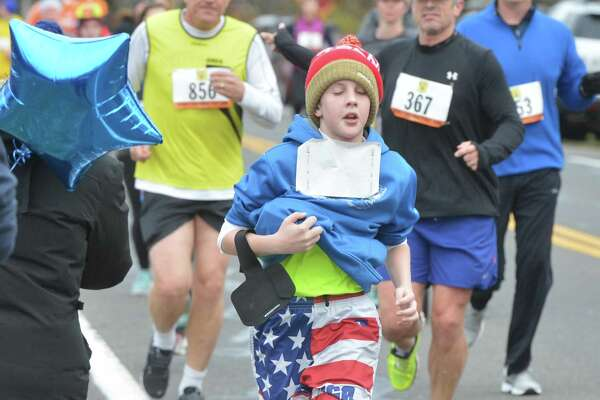 Over 1000 people take part in The annual Rowayton Turkey Trot run held on Thanksgiving morning to raise funds for the Rowayton Arts Center, the Rowayton Gardeners and the Rowayton Volunteer Fire Department, on Thursday November 24, 2016 in Norwalk Conn.