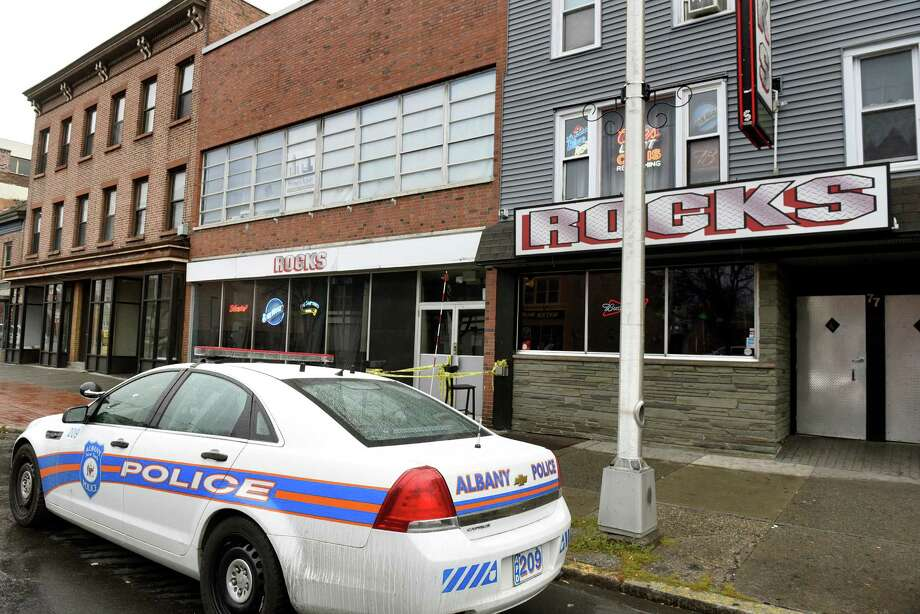 An Albany Police car is parked in front of Rocks after a shooting on Thursday, Nov 24, 2016, in Albany, N.Y. (Cindy Schultz / Times Union) Photo: Cindy Schultz / Albany Times Union