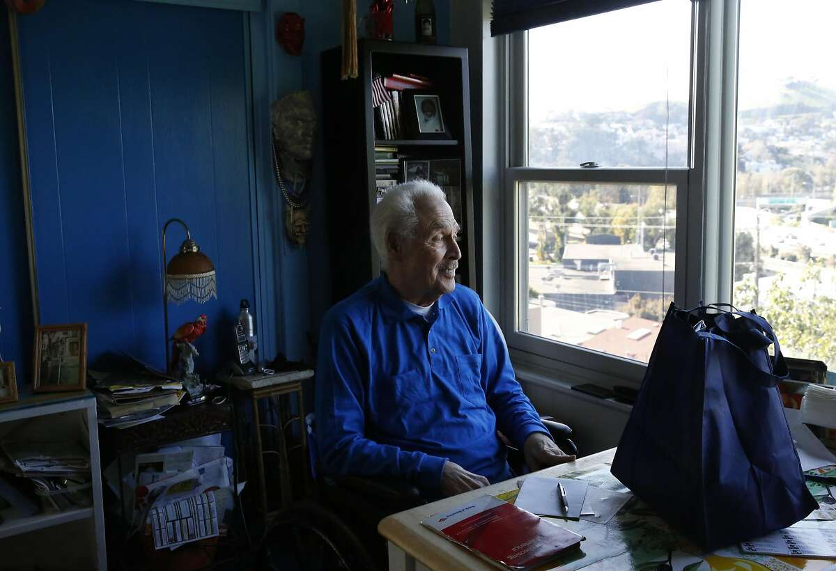 Bernie, 90, who preferred to only give his first name, looks out through his window as his Meals on Wheels delivery sits on the table in front of him in his home Nov. 24, 2016 in San Francisco, Calif.