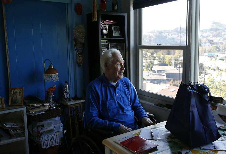 Bernie, 90, who preferred to only give his first name, looks out through his window as his Meals on Wheels delivery sits on the table in front of him in his home Nov. 24, 2016 in San Francisco, Calif. Photo: Leah Millis, The Chronicle