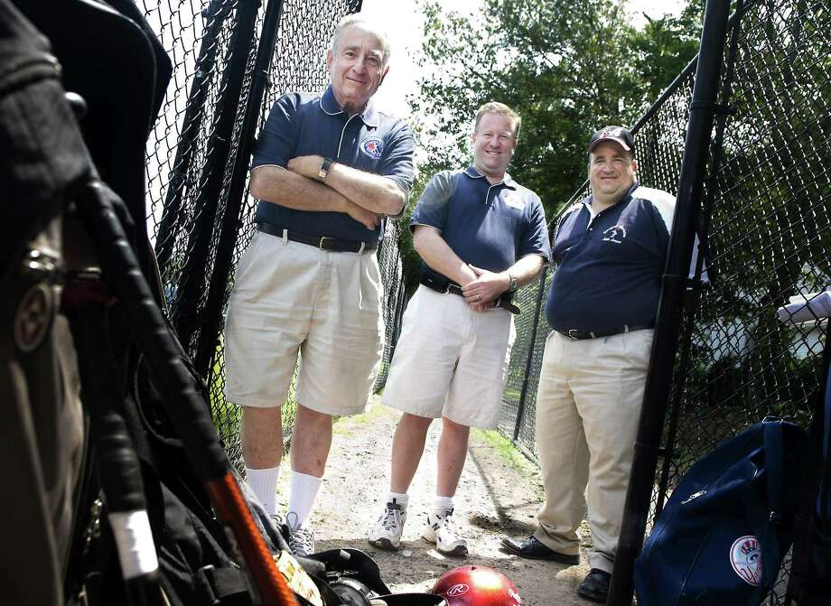 Stamford_071109_ (L to R)  Larry Miller and his sons, Scott Miller and Russ Miller at the Stamford American Little League field on Vine Rd.  Kathleen O'Rourke/Staff photo Photo: Kathleen O'Rourke / ST