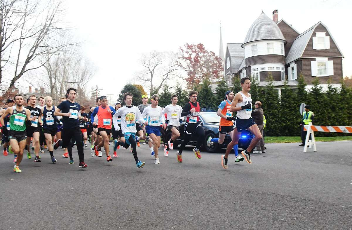 Patrick Corona, right, leads the pack at the start and holds that lead to finish first in the 39th Annual Pequot Road Race in Southport, Conn., Nov. 24, 2016.