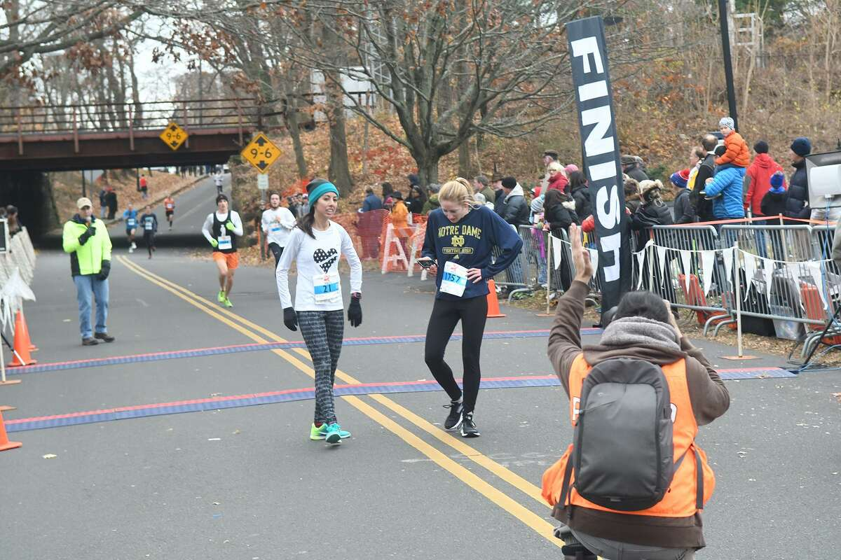 Meg Ryan, left, and Haley Abing were the first and second women respectively to finish in the 39th Annual Pequot Road Race in Southport, Conn., Nov. 24, 2016.