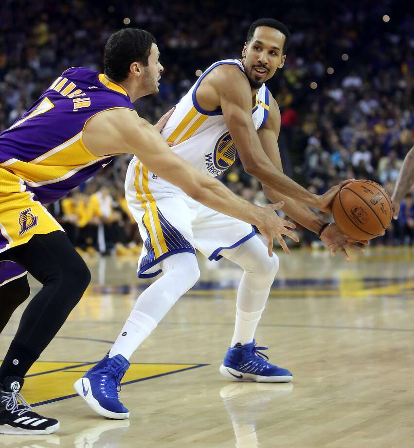 When Shaun Livingston (right) signed for $5.7 million this season, he donated generously to his grade school. Photo: Scott Strazzante, The Chronicle