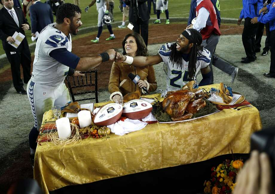 It's been downhill for the 49ers ever since Seattle's Russell Wilson (left) and Richard Sherman feasted at Levi's Stadium. Photo: Scott Strazzante, The Chronicle