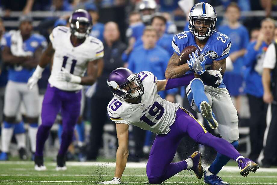Detroit's Darius Slay intercepts a pass in front of Minne- sota's Adam Thielen with 30 seconds left in the fourth quarter to set up the Lions' winning field goal. Photo: Gregory Shamus, Getty Images