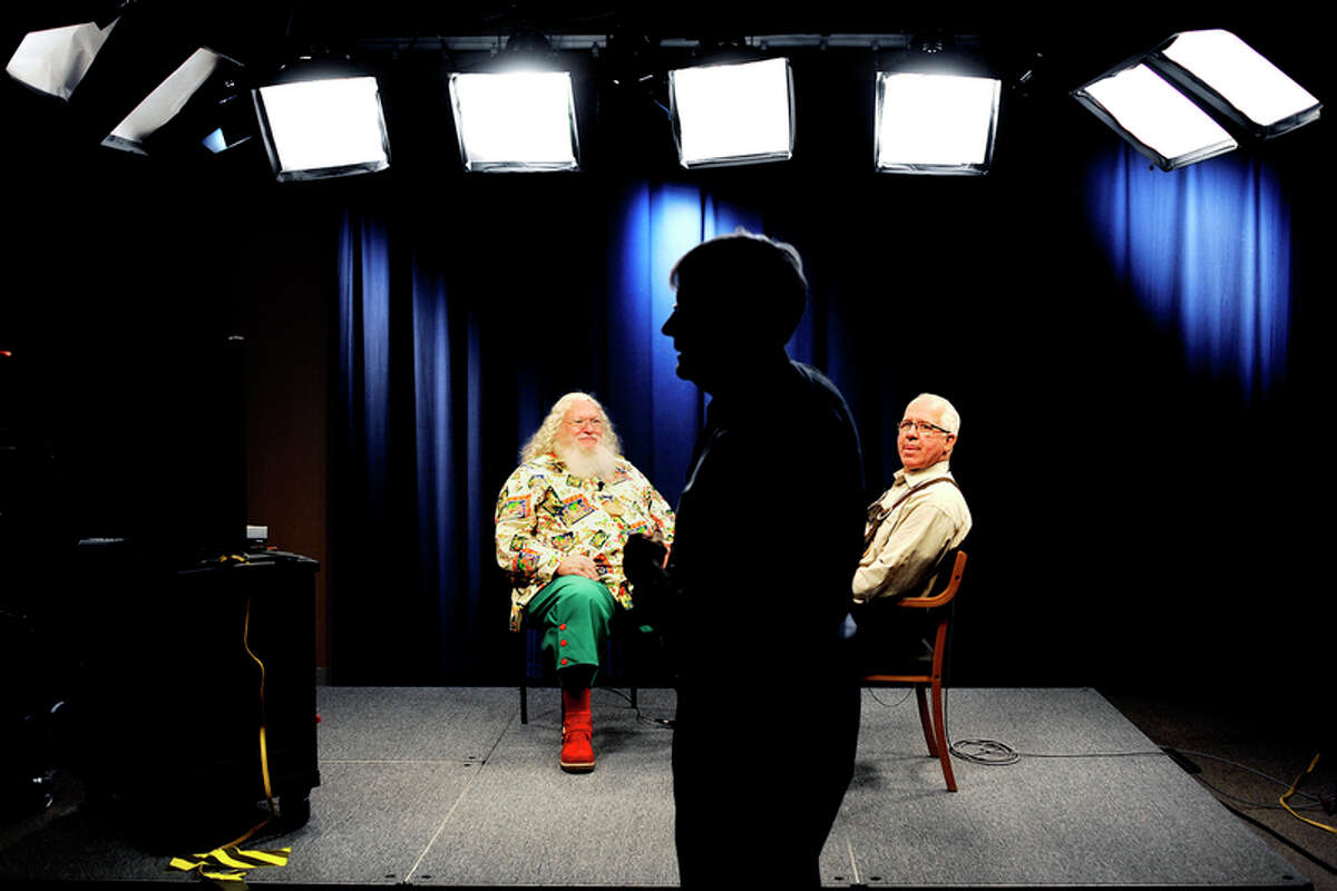 Charles W. Howard Santa Claus School Dean Tom Valent, right, and student John Bloomberg, left, of Headrick, Oklahoma, get ready for a mock interview as Ron Beacom, MCTV station director, center, looks on in this 2011 file photo.