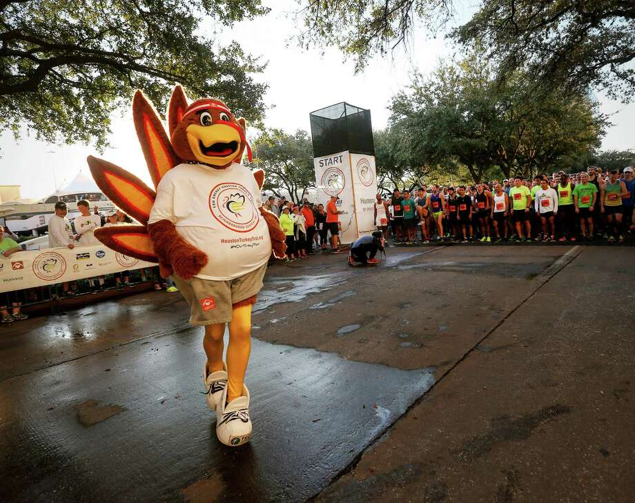 PHOTOS: Houston' favorite holiday traditionsSassy the Turkey warms up before the start of the 2016 Houston Turkey Trot. For 25 years Houstonians have been waking up early on Thanksgiving Day and running a few miles for a great cause while the rest of us baste a turkey. See what holiday traditions Houstonians can't get enough of... Photo: Jon Shapley, Staff / © 2015  Houston Chronicle