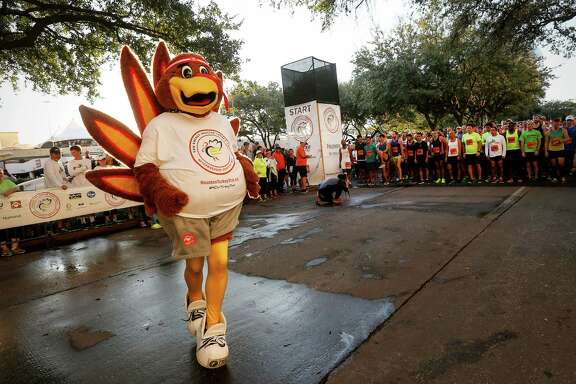 Sassy the turkey warms up before the start of the 2016 Houston Turkey Trot on Thursday.
