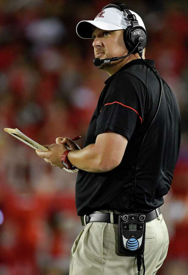 In this Sept. 29, 2016, file photo, Houston head coach Tom Herman watches from the sideline in the second half of an NCAA college football game against Connecticut, in Houston. Houston plays Memphis on Saturday. Photo: Eric Christian Smith, Associated Press / FR171023 AP