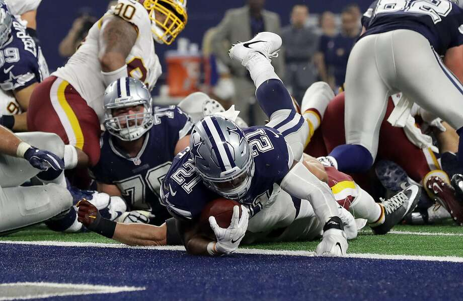 Dallas' Ezekiel Elliott dives into the end zone for a touchdown during the fourth quarter against Washington at AT&T Stadium in Arlington, Texas. Photo: Ronald Martinez, Getty Images
